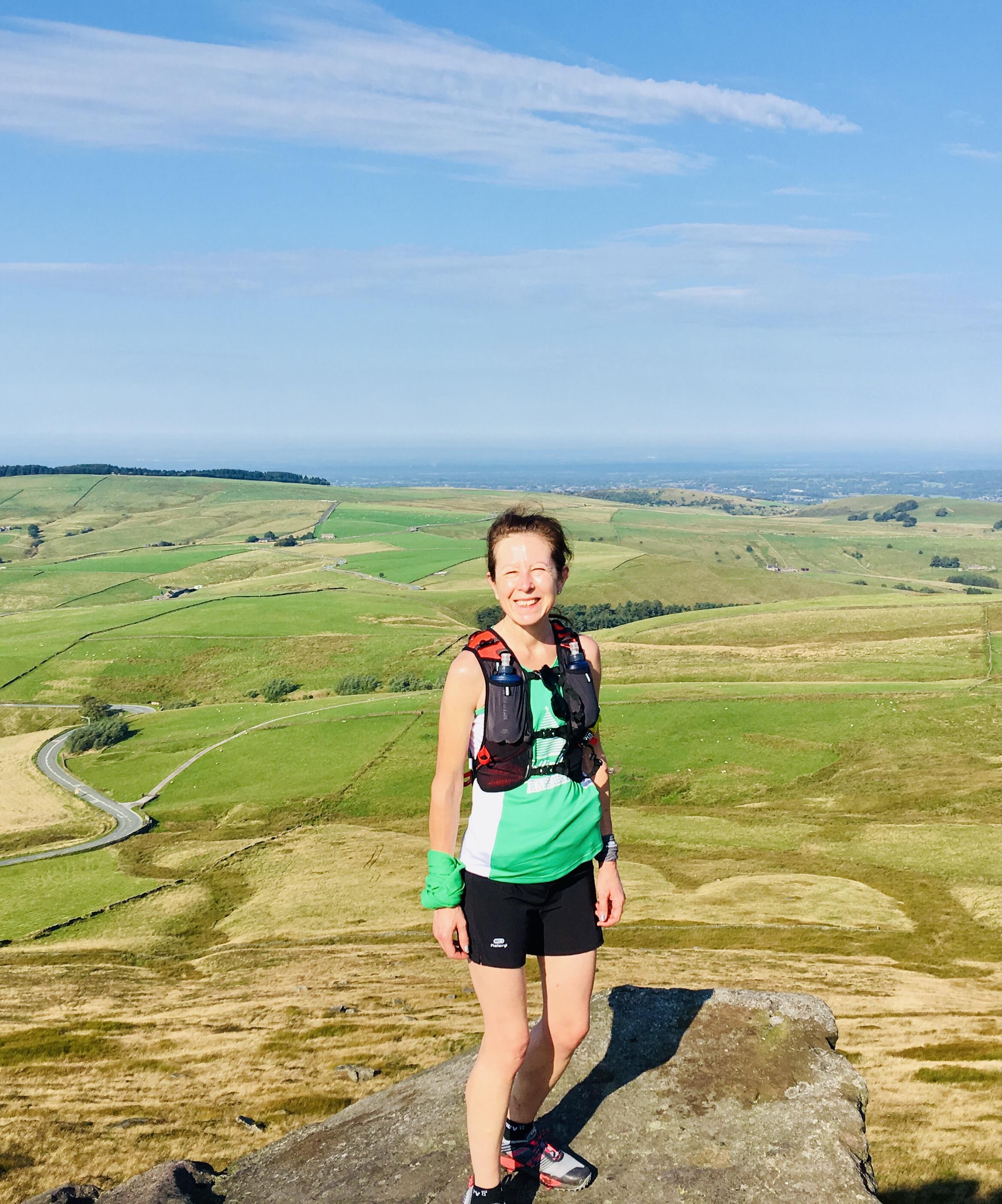 Sara running in the peak district
